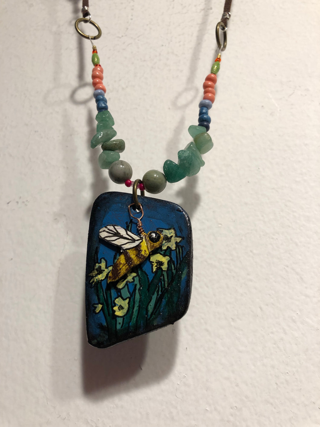 Day and Night jewelry line created by Sharon Pena  is crafted of leather, various stones and beads.  This line is all hand painted.