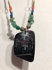 Day and Night line of jewelry from Sharon Pena is reversible. This depicts the Chicago Skyline at night.  The reverse side depicts a bumblebee tending to her flowers.