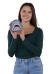 Scary Shark Wristlet with Chained Bloody Hand in Vinyl Material, handheld by model