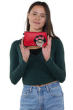 Rose Hair Unibrow Girl Wristlet in Vinyl, handheld by model