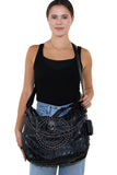 Studded Skull Hobo Bag in Vinyl Material, crossbody style on model