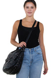 Studded Skull Hobo Bag in Vinyl Material, crossbody style on model, side view