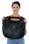 Studded Skull Hobo Bag in Vinyl Material, front view on model