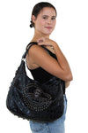 Studded Skull Hobo Bag in Vinyl Material, shoulder bag style on model
