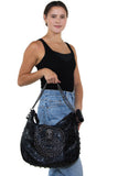 Studded Skull Hobo Bag in Vinyl Material, side view on model, handheld style