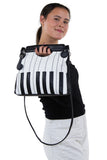 Piano Keys Handbag in Vinyl, handheld style on model