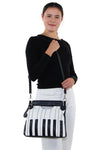 Piano Keys Handbag in Vinyl, shoulder bag style on model