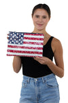 Floral American Clutch and Wristlet in Coated Canvas Material, front view, handheld by model