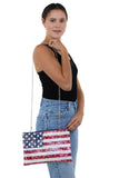 Floral American Clutch and Wristlet in Coated Canvas Material, shoulder bag style on model
