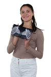 Mirrored Zebras Clutch in Vinyl Material, front view, handheld by model