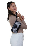 Mirrored Zebras Clutch in Vinyl Material, wristlet style on model