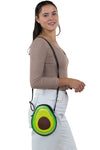 """Have a Heart"" Avocado Crossbody Bag in Vinyl Material, shoulder bag style on model"
