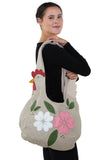 Floral Chicken Hobo in Canvas Material, shoulder bag style on model