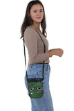 Sleepyville Critters - Frankenstein Crossbody Bag in Vinyl, shoulder bag style on model