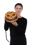 Sleepyville Critters - Pumpkin Two Faced Jack O Lantern Crossbody Bag in Vinyl Material, glittery side, handheld by model