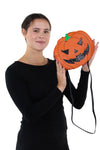 Sleepyville Critters - Pumpkin Two Faced Jack O Lantern Crossbody Bag in Vinyl Material, no glitter side, handheld by model