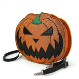 Sleepyville Critters - Pumpkin Two Faced Jack O Lantern Crossbody Bag in Vinyl Material, glitter side, side view