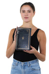Book of Wealth Book Clutch Cross Body Bag in Vinyl Material, back view, handheld by model