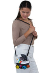 Roller Blade Cross Body Bag in Vinyl Material, shoulder bag style on model