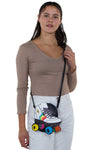 Roller Blade Cross Body Bag in Vinyl Material, crossbody style on model