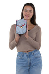 Lucky Grey Cat Cross Body Bag in Vinyl Material, handheld by model
