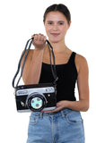 Camera Cross Body Bag in Vinyl, front view, handheld by model
