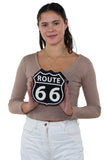 Route 66 Cross Body Bag in Vinyl Material, front view, handheld by model