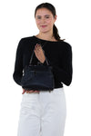 Studded Skull Shoulder Bag in Vinyl, back view of purse, handheld by model