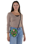 Sugar Skull Alien Crossbody Bag in Vinyl, crossbody style on model