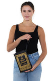 The Witches Companion Book Bag in Vinyl, wristlet style on model