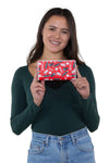 Officially Licensed Coca-Cola Drinks Wallet in Vinyl Material, handheld by model