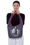 Officially Licensed Classic Glass Bottle Coca-Cola University Hobo Bag, front view, handheld by model