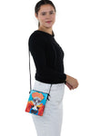 Sugar Skull Unibrow Girl Crossbody Bag in Vinyl Material, shoulder bag style on model