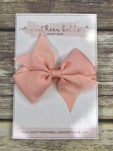 Peach pinwheel bow headband