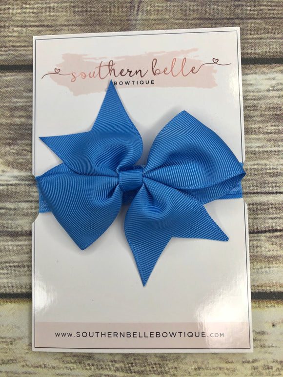 Medium blue pinwheel bow headband