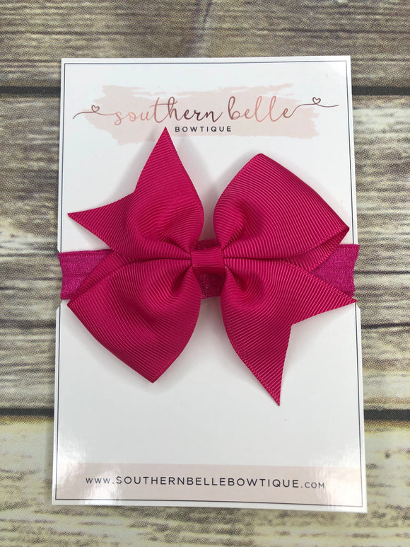 Shocking pink pinwheel bow headband