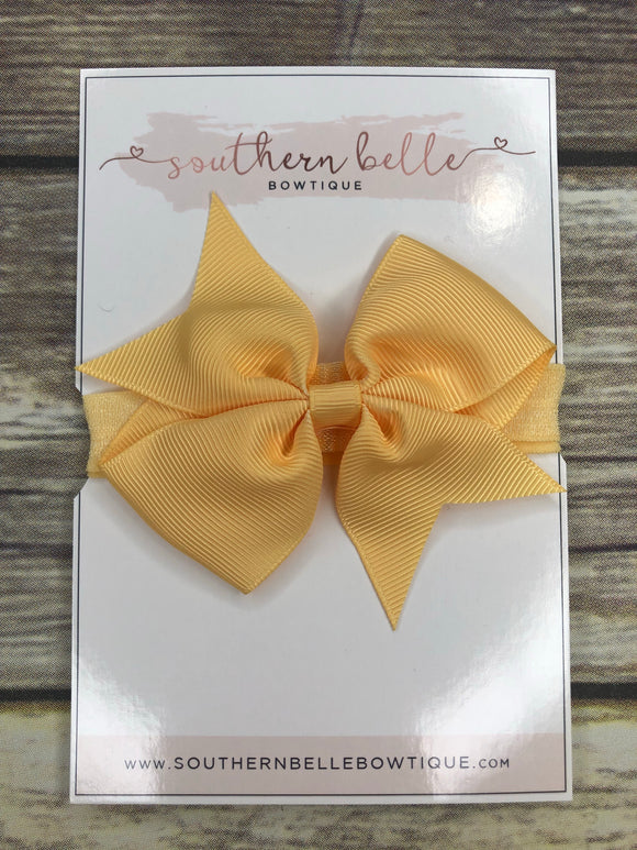 Light yellow pinwheel bow headband