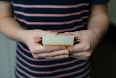 One of Aerende's makers with a soap bar