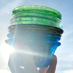 stack of glass bowls in sunlight