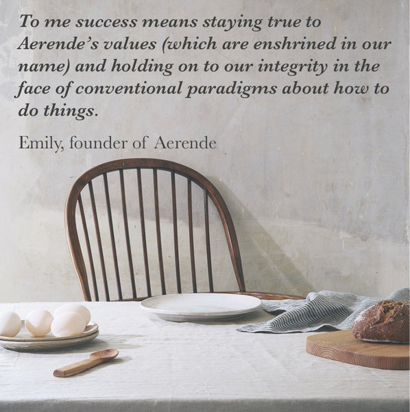 quote from Emily, founder of Aerende about success on a background image of an dining table.