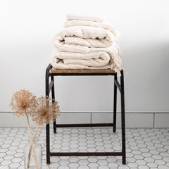 folded towels on a stool