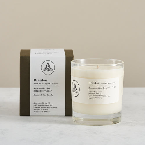 Aerende Braeden candle boxed and packaged alongside unwrapped version in glass