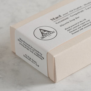 Bar of Aerende's Maed soap at an angle in cream and white packaging