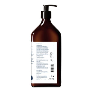 Reverse view of LA-EVA BLÜ lotion in brown apothecary bottle with white background