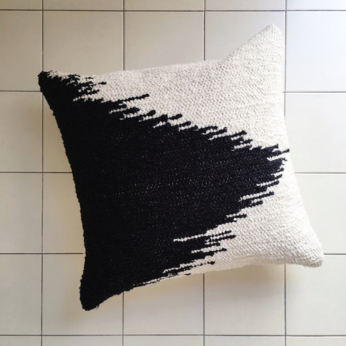 Casa Cubista Fade black and cream cushion on white tiles