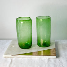 Load image into Gallery viewer, Two Ishkar tall green tumblers on a white and gold tile on a white cloth with white background