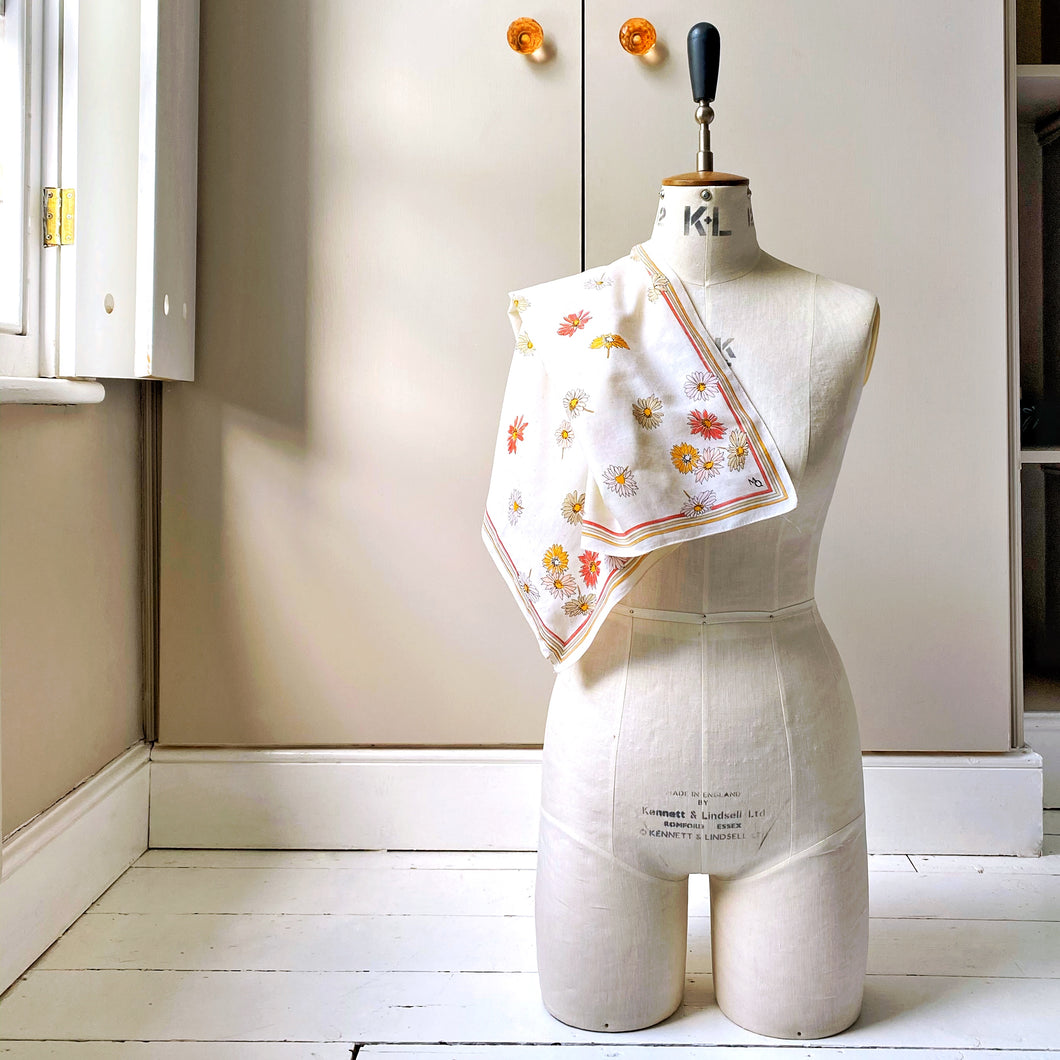 Vintage Mary Quant scarf draped across the shoulder of a tailor's dummy with taupe wardrobe in background
