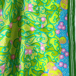 Close-up of bright green psychedelic 60s scarf