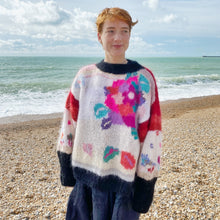 Load image into Gallery viewer, 1980s floral jumper and navy skirt on redhead model at the beach, sea in background