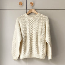 Load image into Gallery viewer, Cream aran jumper on hanger against taupe wardrobe